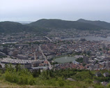 Stock Video Footage of BERGEN Norway: View from Mt Floyen at City center hanseatic town, harbor + pan