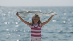 Slow-Mo: Girl Holding Silk Scarf Against The Wind At The Sea Stock Footage