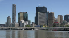 Ferry arriving with Brisbane skyline on the background Stock Footage