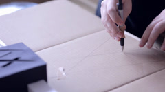 Drawing Circle on Paperboard - stock footage