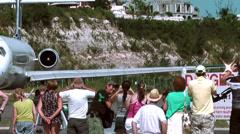 Sint Maarten Maho Beach 044 people behind a starting aircraft Stock Footage
