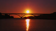 Dramatic Sunset Over Arched Bridge Stock Footage