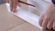 Stock Video Footage of Gluing a Building Model on Paperboard