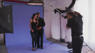 Male & Female Models with Apple in Photo Shoot Stock Footage