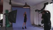 Blonde Model in High Heels in Photo Shoot Stock Footage