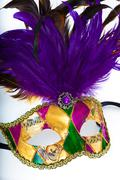 A colorful mardi gras or venetian mask on a white background Stock Photos