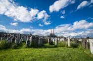 Stock Photo of dramatic shot of cemetery with clouds