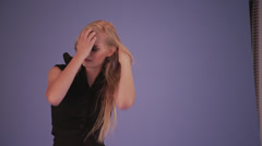 Blonde Model Adjusting Hair for Photo Shoot Stock Footage