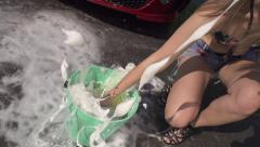 SLOW MOTION: Splashing a sponge into the bucket Stock Footage