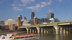 Cannon Street train station railway bridge cruise pass London cityscape day sky Stock Footage