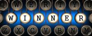 Stock Illustration of Winner on Old Typewriter's Keys.