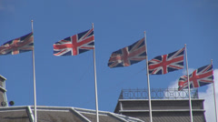 Group british flag wave wind UK United Kingdom national symbol blue sky sunny  Stock Footage