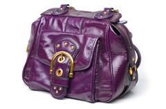 purple leather handbag - stock photo