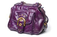 Stock Photo of purple leather handbag