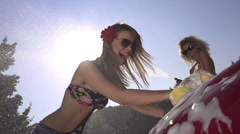 SLOW MOTION: Cheerful young women washing a car Stock Footage