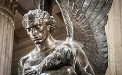 Statue of angel holding body Stock Photos