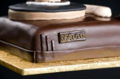 Cake on isolated black background Stock Photos