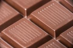 macro shot of dark chocolate bar. - stock photo