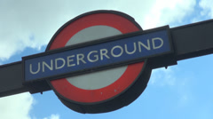 Timelapse metro sign station subway London blue sky cloud pass day direction UK Stock Footage