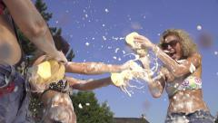 SLOW MOTION: Young women splashing foam on each other Stock Footage