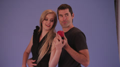 Male & Female Model Pose with Red Apple Stock Footage