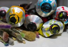macro shot of paint and brushes - stock photo