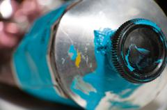 macro shot of blue paint tube - stock photo