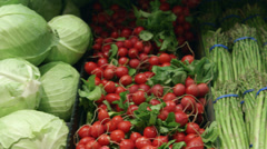 Close-up tracking shot of vegetables in a supermarket Stock Footage