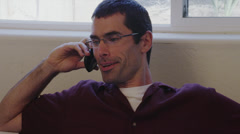 Dark-Haired Man Talking on Cell Phone Stock Footage