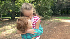 Slow-Mo: Boy And Girl Expressing Affection By Hugging - stock footage
