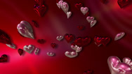 Stock Video Footage of Shiny Silver and Pink Love Hearts on a 3D Abstract Red Background