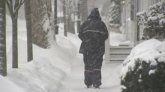Mailman in snow Stock Footage