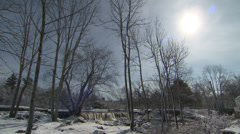 Bare trees and waterfall Stock Footage