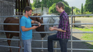 Two Men Talk at Horse Rank, Zoom In Stock Footage