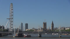 Hungerford Bridge London Eye Ferris wheel Palace Westminster Big Ben bell Clock  Stock Footage
