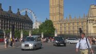 Stock Video Footage of Traffic car street red bus double decker London Eye Parliament building people