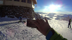 Hand holding phone on winter background, pov, Alps, Zillertal, Austria HD Stock Footage