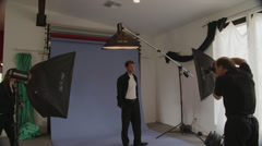 Stock Video Footage of Male Model Gets Make Up in Shoot