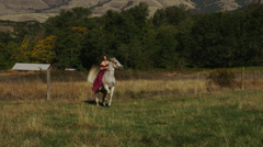 Woman Rides Horse Rearing Up, Slow-Motion Stock Footage