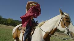 Muscular Cowboy on Horseback Stock Footage