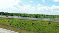 Aerial View. Cars passing on the highway Stock Footage