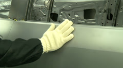 Quality testing with hand in automobile factory - stock footage