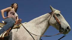 Woman on White Horse, Shot from Below Stock Footage