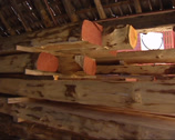 Stock Video Footage of Pile of timber, stored for restoration + pan