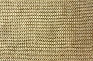 Stock Photo of tan knitted tweed fabric background