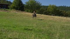 Shirtless Man Riding Fast Horse, Camera Pan Stock Footage