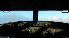Airplane flying into the clouds - stock footage