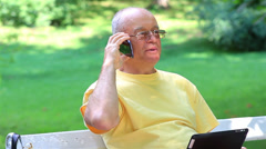 Senior man talking on smart phone - stock footage