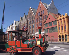 Street view Bryggen, Sightseeing tour bus and trade houses Stock Footage