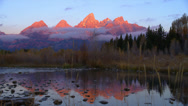 Stock Video Footage of Gorgeous Grand Tetons in Mist